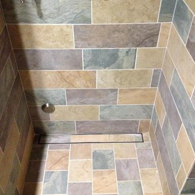 A Steam Shower Installation Featuring The LUXE Tile Insert Linear Shower  Drain.