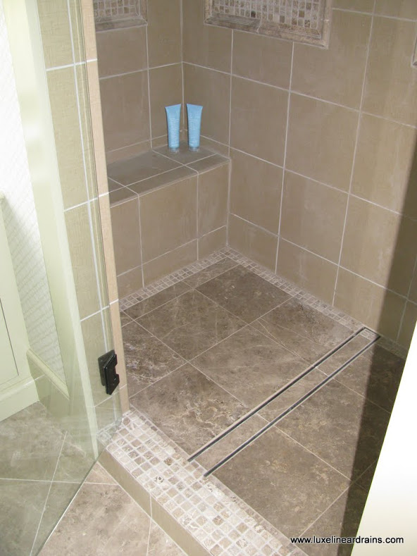 make your drain disappear with a tile insert design luxe